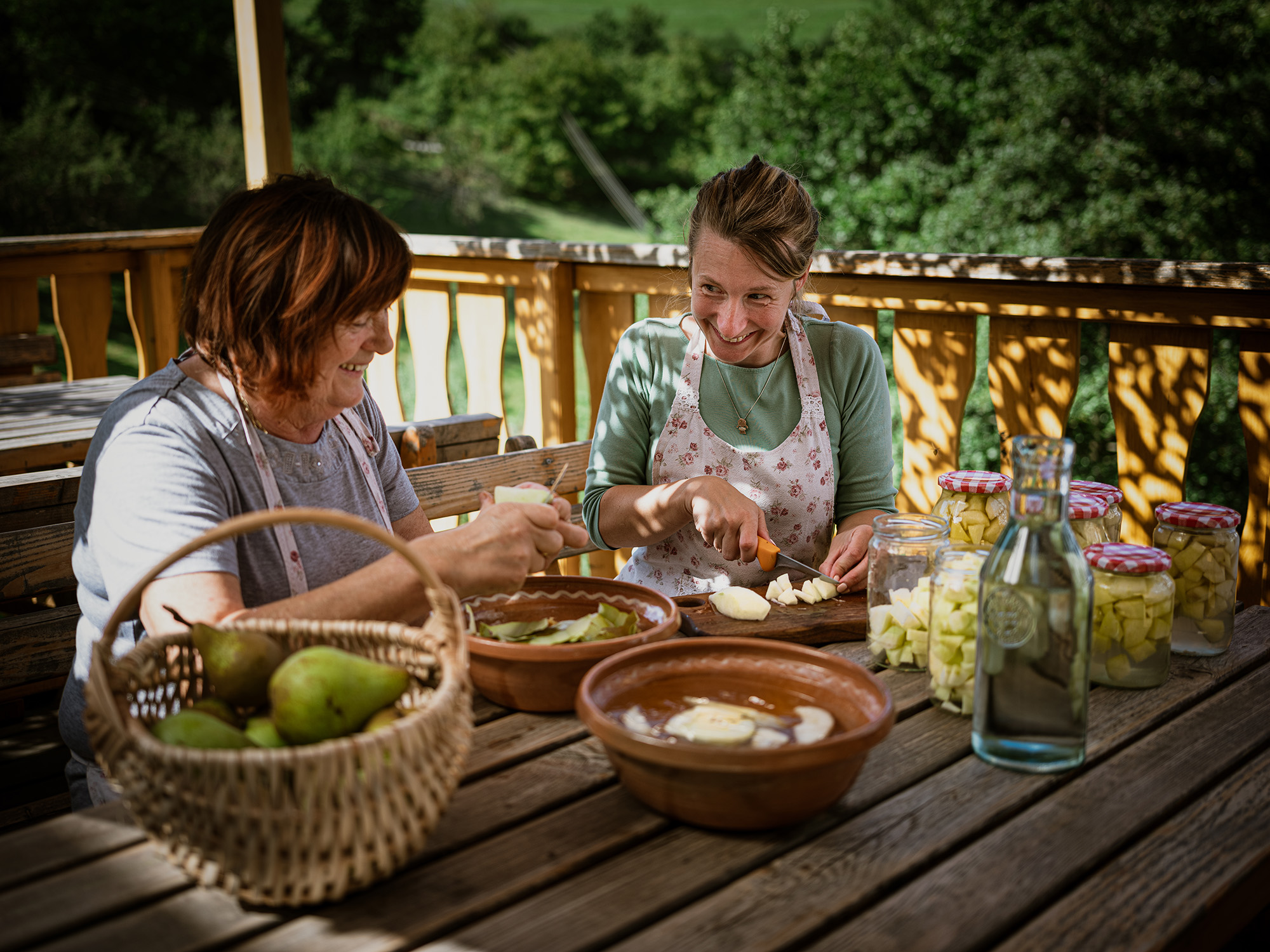 Urška and Vilma preparing food
